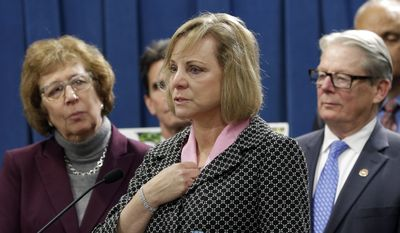 In this Wednesday, Jan. 21, 2015, file photo, Debbie Ziegler, center, the mother of Brittany Maynard, speaks in support of proposed legislation allowing doctors to prescribe life-ending medication to terminally ill patients, during a news conference at the Capitol, in Sacramento, Calif. (AP Photo/Rich Pedroncelli, File)
