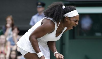 Serena Williams of the United States celebrates winning a point againstVictoria Azarenka of Belarus during their singles match at the All England Lawn Tennis Championships in Wimbledon, London, Tuesday July 7, 2015. (AP Photo/Pavel Golovkin)