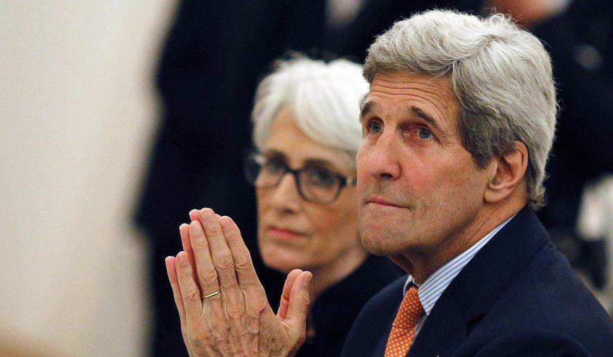 U.S. Secretary of State John Kerry, front, and U.S. Under Secretary for Political Affairs Wendy Sherman meet with foreign ministers of Germany, France, China, Britain, Russia and the European Union at a hotel in Vienna, Austria, Tuesday, July 7, 2015. (Carlos Barria/Pool photo via AP)