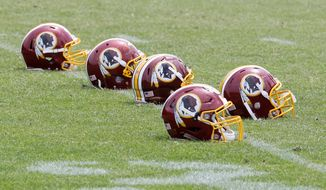 Following a federal judge's decision Wednesday to cancel a half-dozen of the Washington Redskins' federal trademark registrations, public focus has returned to the team moniker and emblems. (Associated Press)