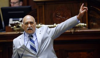 Rep. Mike Pitts, R-Laurens, makes a point as he speaks on the floor of the South Carolina House during debate over a Senate bill calling for the Confederate battle flag to be removed from the statehouse grounds Wednesday, July 8, 2015, in Columbia, S.C. Lawmakers were deliberating a proposal that could remove the banner from the Capitol grounds after the state Senate passed its own measure, which is supported by Governor Nikki Haley. (AP Photo/John Bazemore)
