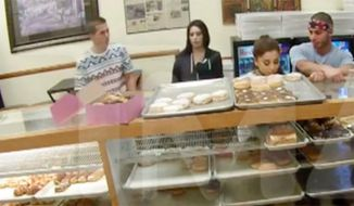 Singer Ariana Grande seemingly licks a doughnut before saying she hates America in video obtained by TMZ July 7, 2015. (Image: TMZ screenshot) ** FILE **