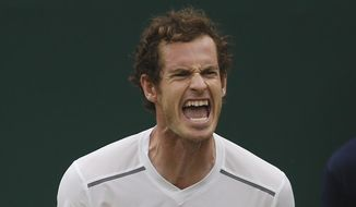 Andy Murray of Britain shouts after a point as he plays Vasek Pospisil of Canada, during their singles match at the All England Lawn Tennis Championships in Wimbledon, London, Wednesday July 8, 2015. (AP Photo/Alastair Grant)