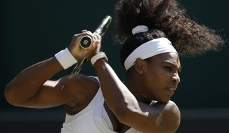 Serena Williams of the United States returns a shot to Maria Sharapova of Russia during the women's singles semifinal match at the All England Lawn Tennis Championships in Wimbledon, London, Thursday July 9, 2015. (AP Photo/Alastair Grant)