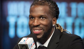 Toronto Raptors' DeMarre Carroll smiles after being introduced at a press conference in Toronto on Thursday, July 9, 2015. Carroll played for the Atlanta Hawks last season. (Darren Calabrese/The Canadian Press via AP)