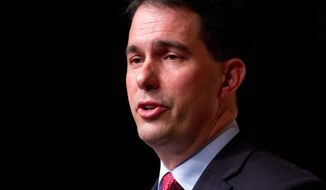 Potential GOP presidential candidate Wisconsin Gov. Scott Walker drew praise from social conservatives for his plan to sign a 20-week abortion ban. (Associated Press)