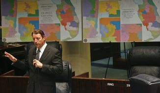 Senate Reapportionment Chairman Sen. Bill Galvano, R-Bradenton discusses an amendment on the floor of the Senate Monday, August 11, 2014, at the Capitol in Tallahassee, Fla. Behind him are maps of the 2012 Florida congressional districts, left, and the redrawn districts he is proposing in Senate Bill 2. Legislators are meeting for a rare summer one-week special session, to redraw the boundary lines of two congressional districts ruled unconstitutional last month, and have a Friday deadline for a resolution. (AP Photo/Phil Sears) **FILE**
