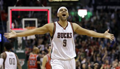 Milwaukee Bucks' Jared Dudley celebrates after Game 4 of an NBA basketball first-round playoff series against the Chicago Bulls Saturday, April 25, 2015, in Milwaukee.