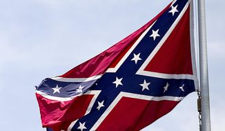 A Confederate flag flies at the base of Stone Mountain in Stone Mountain, Ga. (AP Photo/David Goldman, File)