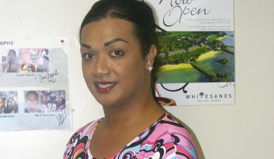 """Princess Auvaa poses for a photo in Pago Pago, American Samoa, Thursday, July 9, 2015. Mr. Auvaa is a """"faafafine,"""" a male who is raised as a female and takes on feminine traits. American Samoa's attorney general is reviewing whether the Supreme Court's gay marriage decision applies to the U.S. territory. (AP Photo/Fili Sagapolutele)"""