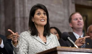 South Carolina Gov. Nikki Haley speaks during a ceremony where she signed a bill into law, Thursday, July 9, 2015, at the Statehouse in Columbia, S.C. The law enables the removal of the Confederate flag from the Statehouse grounds more than 50 years after the rebel banner was raised to protest the civil rights movement. (AP Photo/John Bazemore)