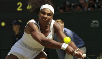 Serena Williams of the United States returns a shot to Garbine Muguruza of Spain during the women's singles final at the All England Lawn Tennis Championships in Wimbledon, London, Saturday July 11, 2015. (Sean Dempsey/Pool Photo via AP)
