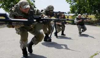 In this photo taken on Thursday, June  25, 2015, members of a self-defense unit carry out exercise drills in a location outside Odessa, Ukraine. Odessa lies more than 500 kilometers (300 miles) west of the front line in east Ukraine, where government troops are mired in a war of attrition against Russian-backed separatists. (AP Photo/Sergei Chuzavkov)
