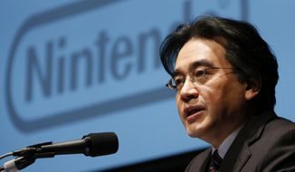 Satoru Iwata led Nintendo's development into a global company, with its hit Wii home console, and also through its recent woes caused by the popularity of smartphones. (Associated Press)