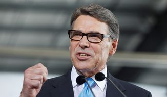 Presidential hopeful Rick Perry called on Donald Trump to end his presidential bid on July 18, 2015. (Associated Press) ** FILE **