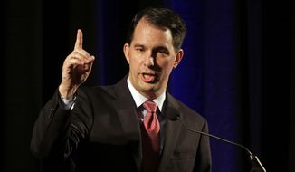 Republican Gov. Scott Walker of Wisconsin, whom many have long predicted would enter the GOP race to become the party's 2016 nominee, is expected to announce his candidacy Monday. Mr. Walker made a name for himself battling labor unions and surviving a state recall effort. (Associated Press)