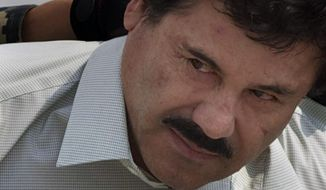 """Joaquin """"El Chapo"""" Guzman is escorted to a helicopter in handcuffs by Mexican navy marines at a navy hanger in Mexico City, Feb. 22, 2014. (AP Photo/Eduardo Verdugo, file) ** FILE **"""