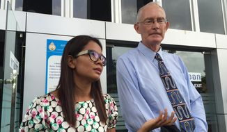 Alan Morison, right, Australian editor of the website Phuketwan and his colleague Chutima Sidasathien speak to the media ahead of their appearance in court to face charges of violating Thailand's Computer Crime Act in Phuket, Thailand, Tuesday, July 14, 2015. Testimony begins Tuesday in a criminal defamation lawsuit the Thai navy has filed against a small news website over a report it posted alleging naval forces accepted money to abet or turn a blind eye to the seaborne trafficking of refugees from Myanmar. (AP Photo/Thanyarat Doksone)