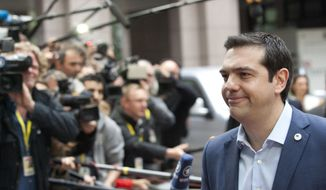 Greek Prime Minister Alexis Tsipras arrives for a meeting of eurozone heads of state at the EU Council building in Brussels on Sunday, July 12, 2015. (AP Photo/Francois Walschaerts)