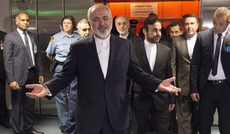 Iranian Foreign Minister Mohammad Javad Zarif arrives for the final plenary meeting at the United Nations building in Vienna, Austria, Tuesday, July 14, 2015.  After 18 days of intense and often fractious negotiation, diplomats Tuesday declared that world powers and Iran had struck a landmark deal to curb Iran's nuclear program in exchange for billions of dollars in relief from international sanctions, an agreement designed to avert the threat of a nuclear-armed Iran and another U.S. military intervention in the Muslim world. (Joe Klamar/Pool Photo via AP)