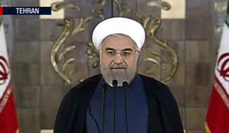 This image made from video broadcast on Press TV, Iran's English language state-run channel shows President Hassan Rouhani making a statement following announcement of the Iran nuclear deal, Tuesday, July 14, 2015 in Teran. Rouhani says 'a new chapter' has begun in relations with the world. (Press TV via AP video)