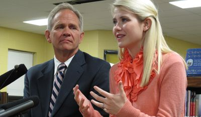 Ed Smart, left,  and daughter Elizabeth Smart talk to reporters before her speech at Scotts Hill High School, where missing Tennessee woman Holly Bobo graduated, on Monday, Aug. 27, 2012 in Scotts Hill, Tenn. Elizabeth Smart, now 24, was abducted in 2002 at age 14 and was held for nine months before she was found just miles from her Utah home. She told Bobo's friends and family Monday night to keep searching for Bobo and don't give up hope she is alive. (AP Photo/Adrian Sainz)