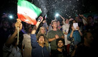 In Tehran, young Iranians danced in streets and motorists honked their horns upon hearing news of the accord. Some people blew South African-style vuvuzela horns like those heard at the World Cup. (Associated Press)