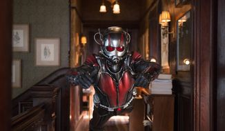 """This photo provided by Disney shows Paul Rudd as Scott Lang/Ant-Man in a scene from Marvel's """"Ant-Man."""" The film releases in the U.S. on July 17, 2015. (Zade Rosenthal/Disney/Marvel via AP)"""
