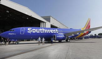 In this Sept. 8, 2014, file photo, a Southwest Airlines plane sits outside a hangar after an event at Love Field in Dallas. (AP Photo/LM Otero, File) ** FILE **