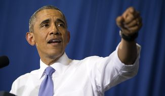 President Barack Obama speaks in the Choctaw Nation on economic opportunities for underprivileged communities across the nation, on Wednesday, July 15, 2015, in Durant, Okla. (AP Photo/Evan Vucci)