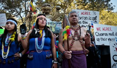 """Protesters rallied outside a federal court in 2013 to protest Chevron's """"racketeering lawsuit against the Ecuadorean rainforest villagers,"""" according to Amazon Watch. The group said the lawsuit was """"retaliatory,"""" but its claims have been found to be dubious. (Associated Press)"""