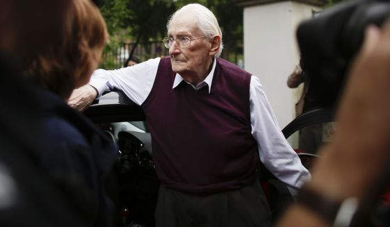 Oskar Groening, a former SS sergeant, arrives for the judgement at the trial against him in in Lueneburg, Germany Wednesday, July 15, 2015. Groening, 94, who is accused of helping to operate the death camp Auschwitz between May and June 1944, has been convicted on 300,000 counts of accessory to murder. The state court gave Groening a four-year sentence. (AP Photo/Markus Schreiber)