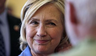 Democratic presidential candidate Hillary Rodham Clinton listens to a question from a guest after a town hall meeting in Dover, N.H., Thursday, July 16, 2015. (AP Photo/Charles Krupa)