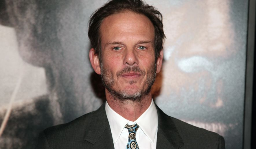 """Director Peter Berg attends the New York premiere of """"Lone Survivor"""" on Tuesday, Dec. 3, 2013, in New York. (Photo by Andy Kropa/Invision/AP)"""
