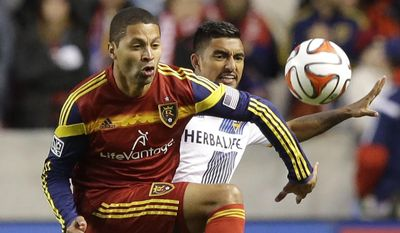 FILE - This Nov. 1, 2014, file photo, shows Real Salt Lake forward Alvaro Saborio, left, and Los Angeles Galaxy defender A.J. DeLaGarza going after the ball in the first half during an MLS Western Conference semifinal, first leg playoff soccer match, in Sandy, Utah. Real Salt Lake has traded Saborio to D.C. United for midfielder Luis Silva. Saborino leaves as RSL's all-time leading scorer with 63 MLS goals and 79 in all matches. The 33-year-old is the second-leading scorer in the league since 2010.  (AP Photo/Rick Bowmer, File)