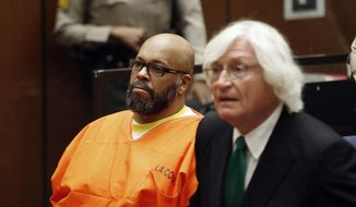 """In this Tuesday, July 7, 2015, photo, Marion Hugh """"Suge"""" Knight, left, sits with his attorney Thomas Mesereau, in Los Angeles Superior Court, during a hearing in a murder case filed against the Death Row Records co-founder. The former rap music mogul Knight returns to court on Friday, July 17, to ask that a judge reduce his bail on murder and attempted murder charges from $10 million.  (Patrick T. Fallon/Pool Photo via AP, File)"""