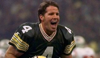 FILE - This Jan. 26, 1997, file photo shows Green Bay Packers quarterback Brett Favre celebrating after throwing a touchdown pass to Andre Rison during first quarter action at Super Bowl XXXI in New Orleans. (AP Photo/Doug Mills, File)