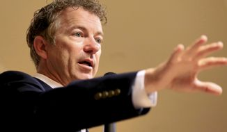 Sen. Rand Paul, Kentucky Republican and presidential hopeful, speaks during a meet and greet event in Council Bluffs, Iowa, on July 1, 2015. (Associated Press) **FILE**