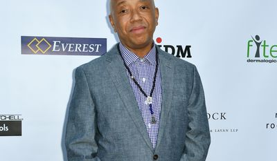 In this May 21, 2015 file photo, Russell Simmons arrives at The17th Annual CAST From Slavery to Freedom Gala in Los Angeles. Simmons spoke Thursday, July 16,  at an event organized by horse carriage opponents and urged New York Mayor Bill de Blasio to follow through on his campaign promise to ban the horse carriages in the city. (Photo by Rob Latour/Invision/AP, File)