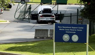 A car tangled in fencing sits parked just inside the gate at the Naval Operational Support Center and Marine Reserve Center where a gunman opened fire Thursday killing four U.S. Marines Friday, July 17, 2015, in Chattanooga, Tenn. (AP Photo/John Bazemore)