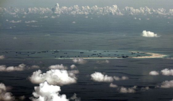 China's alleged on-going reclamation of Mischief Reef in the Spratly Islands in the South China Sea.  (Ritchie B. Tongo/Pool Photo via AP) **FILE**