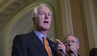 Senate Majority Whip John Cornyn of Texas, speaks next to Senate Majority Leader Mitch McConnell of Ky. during a news conference on Capitol Hill in Washington, in this June 9, 2015, file photo. (AP Photo/Molly Riley, File)