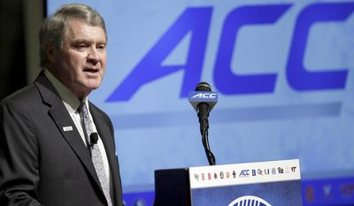 Atlantic Coast Conference Commissioner John Swofford makes remarks during the ACC NCAA college football kickoff in Pinehurst, N.C., Monday, July 20, 2015. (AP Photo/Gerry Broome)