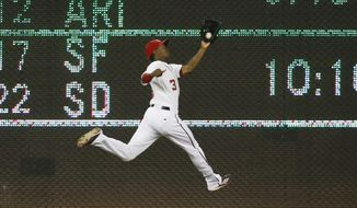 Washington Nationals center fielder Michael Taylor (3) jumps to catch a fly ball hit by New York Mets' Eric Campbell during the fifth inning of a baseball game at Nationals Park, Monday, July 20, 2015, in Washington. (AP Photo/Alex Brandon)