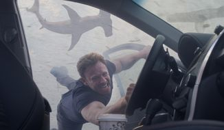 "Ian Ziering portrays Fin Shepard in ""Sharknado 3: Oh Hell No,"" premiering Wednesday at 9 p.m. EDT on Syfy.  (Syfy via AP)"