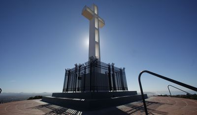The Mount Soledad Memorial Association, the veterans group that maintains the memorial, announced Monday that it has purchased the half-acre of federal land on which the 29-foot Latin cross stands from the Defense Department for $1.4 million. (Associated Press)