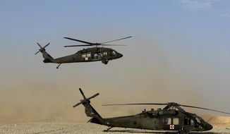 "In this Sunday, Sept. 4, 2011, file photo, a Black Hawk helicopter of the U.S. Army's Task Force Lift & ""Dust Off,"" Charlie Company 1-71 Aviation Regiment, returns from a mission at Forward Operating Base Edi in the Helmand Province of southern Afghanistan. (AP Photo/Rafiq Maqbool, File) ** FILE **"