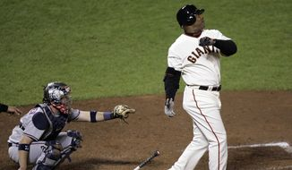 FILE - In this Tuesday, Aug. 7, 2007, file photo,  San Francisco Giants Barry Bonds hits his 756th career home run in the fifth inning of a baseball game against the Washington Nationals in San Francisco. The U.S. Department of Justice formally dropped its criminal prosecution of Barry Bonds, Major League Baseball's career home run leader. The decade-long investigation and prosecution of Bonds for obstruction of justice ended quietly Tuesday morning, July 21, 2015, when the DOJ said it would not challenge the reversal of his felony conviction to the U.S. Supreme Court. (AP Photo/Marcio Jose Sanchez, File)