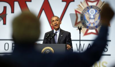 A veteran stands as President Barack Obama addresses the Veterans of Foreign Wars National Convention at the David Lawrence Convention Center in Pittsburgh Tuesday, July 21, 2015. (AP Photo/Gene J. Puskar)