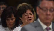 Liz Sullivan, mother of Kathryn Steinle, is consoled by Sabine Durden as she cries during the testimony of Kathryn's father Jim Steinle during a Senate Judiciary hearing in Washington on Tuesday. The family told Congress they support changing the laws that allowed her alleged killer to remain in the United States despite being deported several times. (Associated Press)